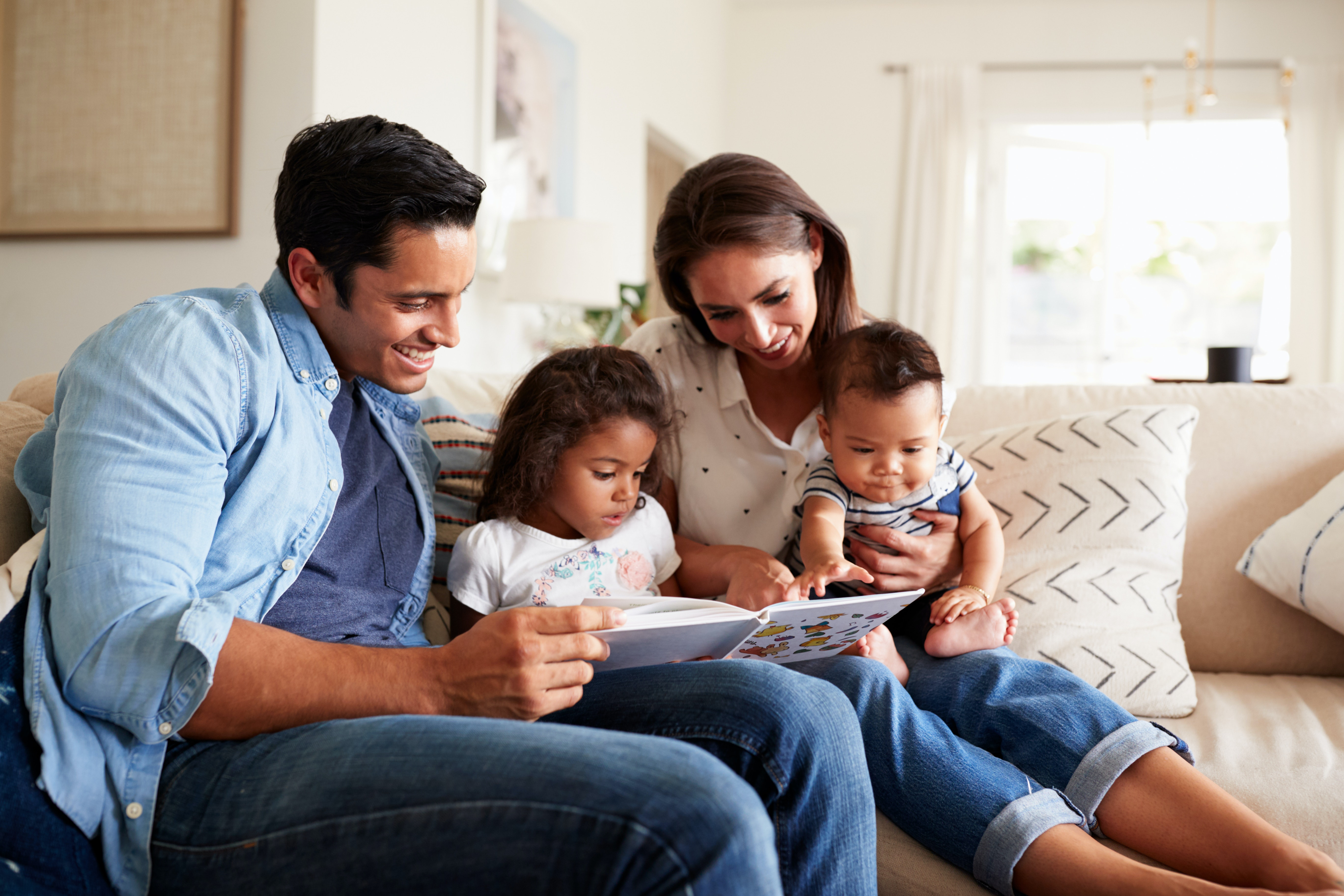 Diverse family sitting together on sofa