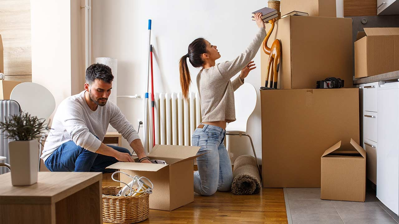 Couple moving into their first home