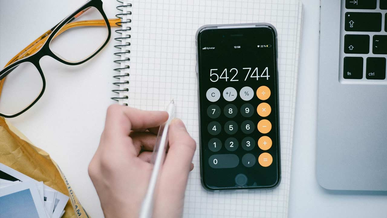 Person using a smartphone as a calculator