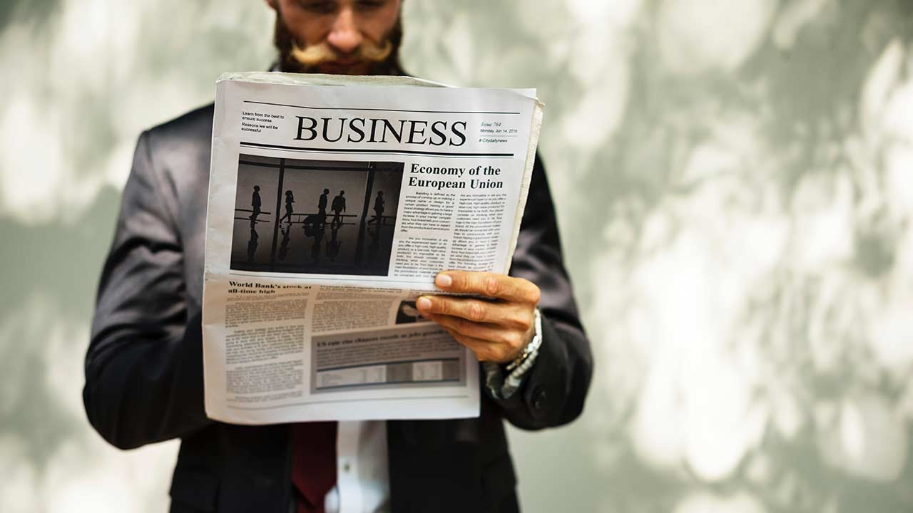 Man reading the business news