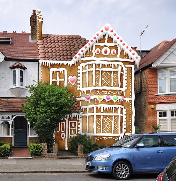 An image of street with a gingerbread house super-imposed onto one of the houses.