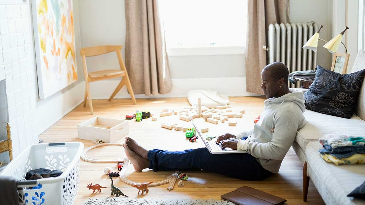 Man doing work in playroom of his house
