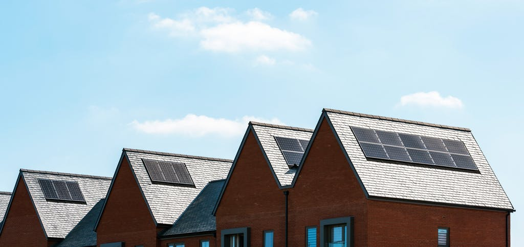 Solar panels on the roofs of homes under the sun