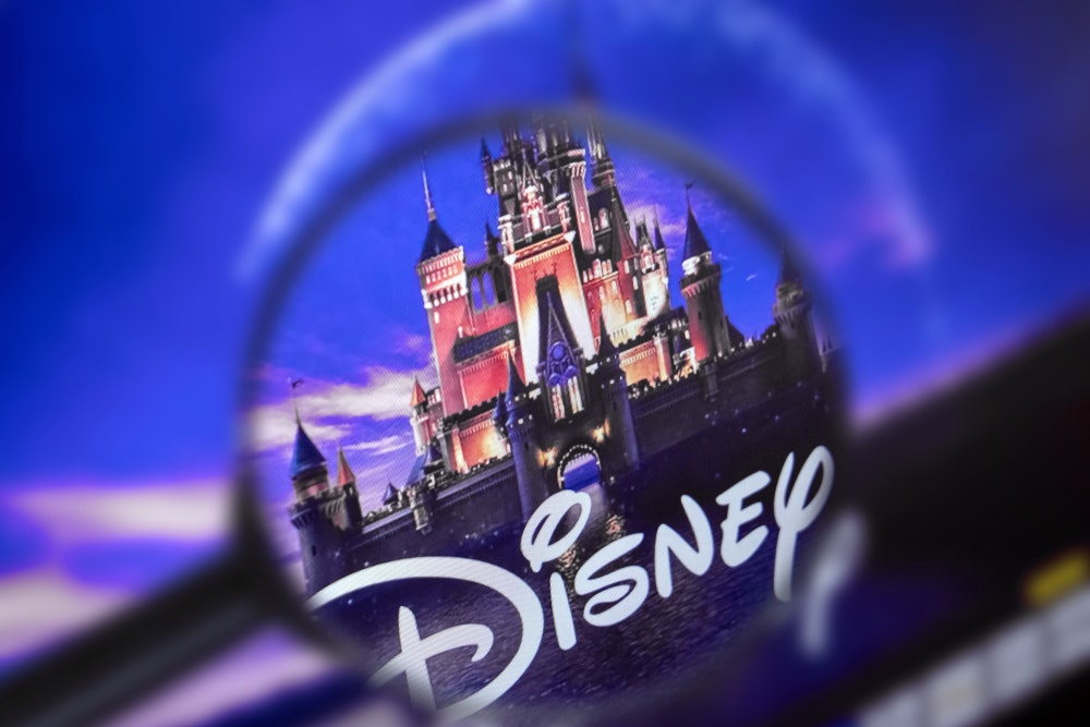 Disney World and logo through magnifying glass