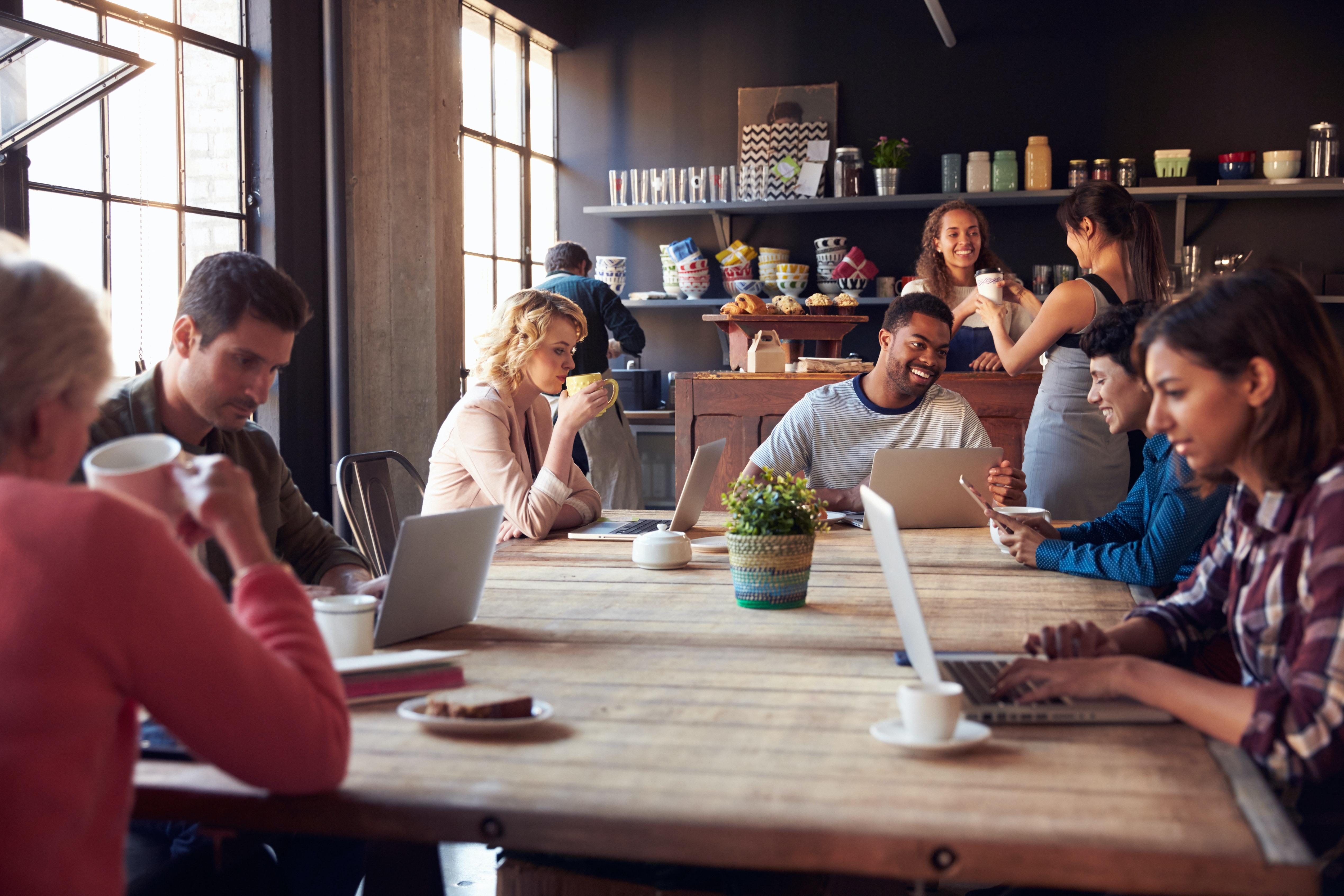 People in coffee shop using broadband