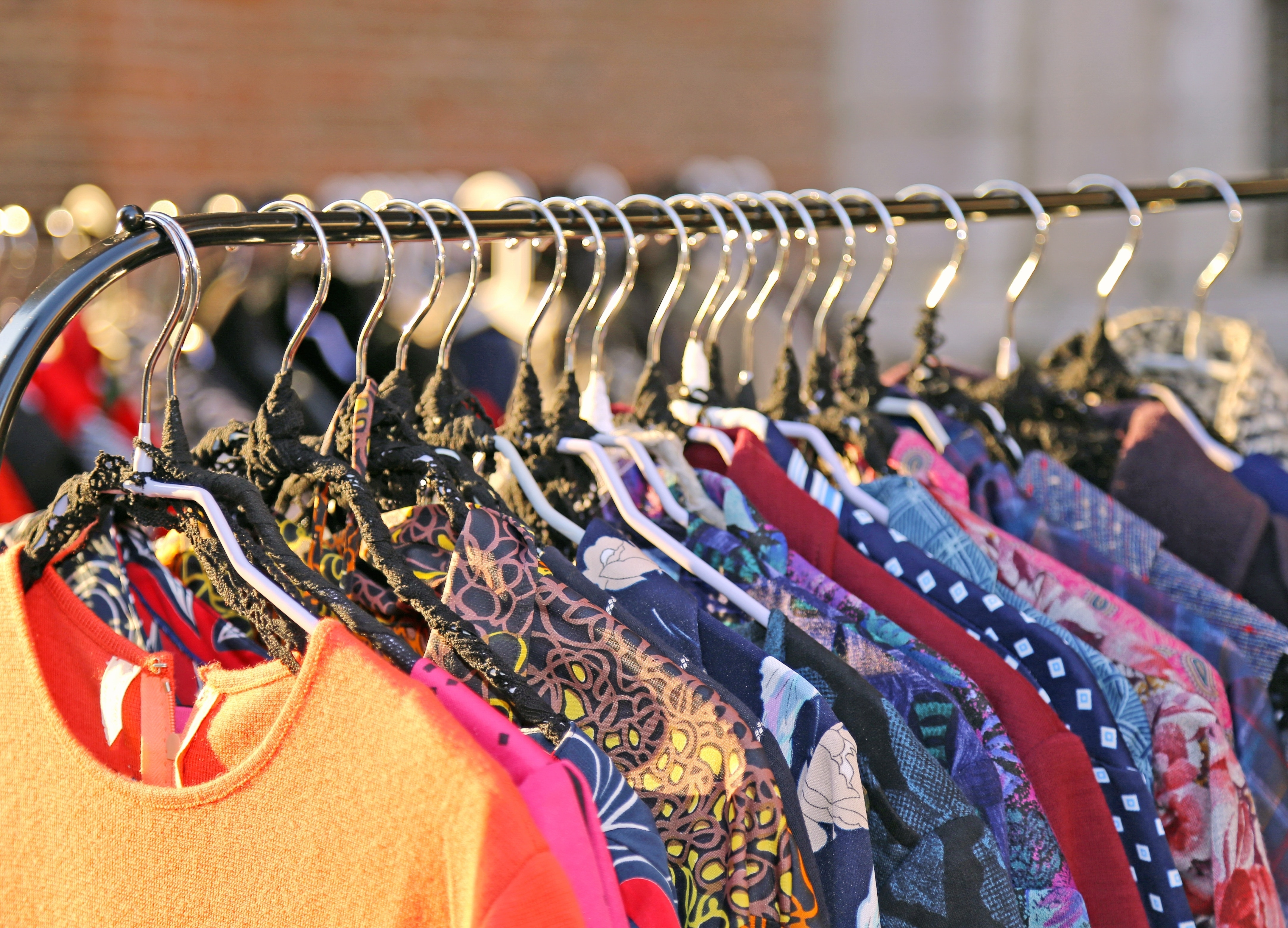 Recycled clothes hanging on rack
