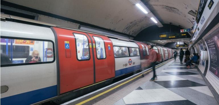 london underground train pulling into a tube platform