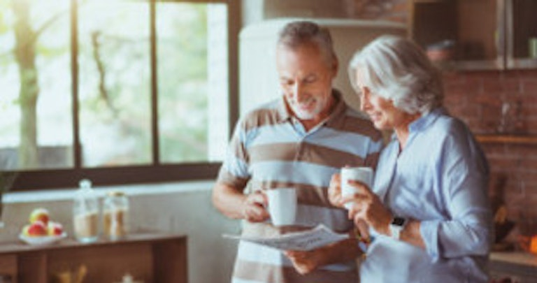 Old couple enjoying life on the Priority Services Register