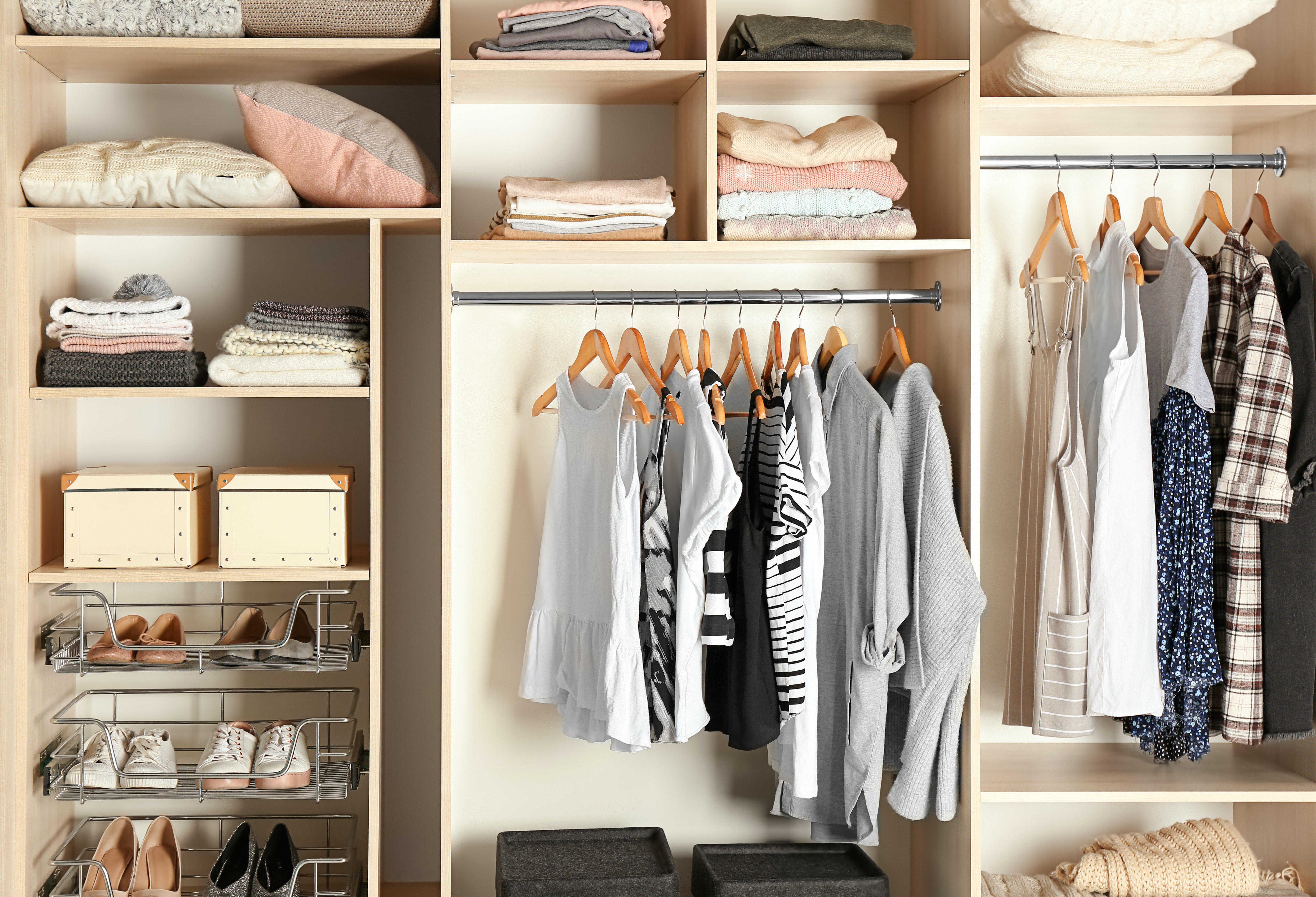 Wardrobe with clothes hanging in it