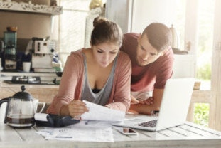 Young couple reading their energy bill