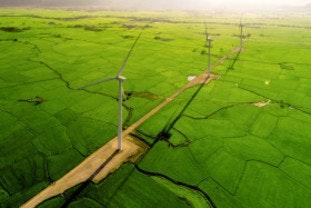 Wind turbines in a field representing various regions