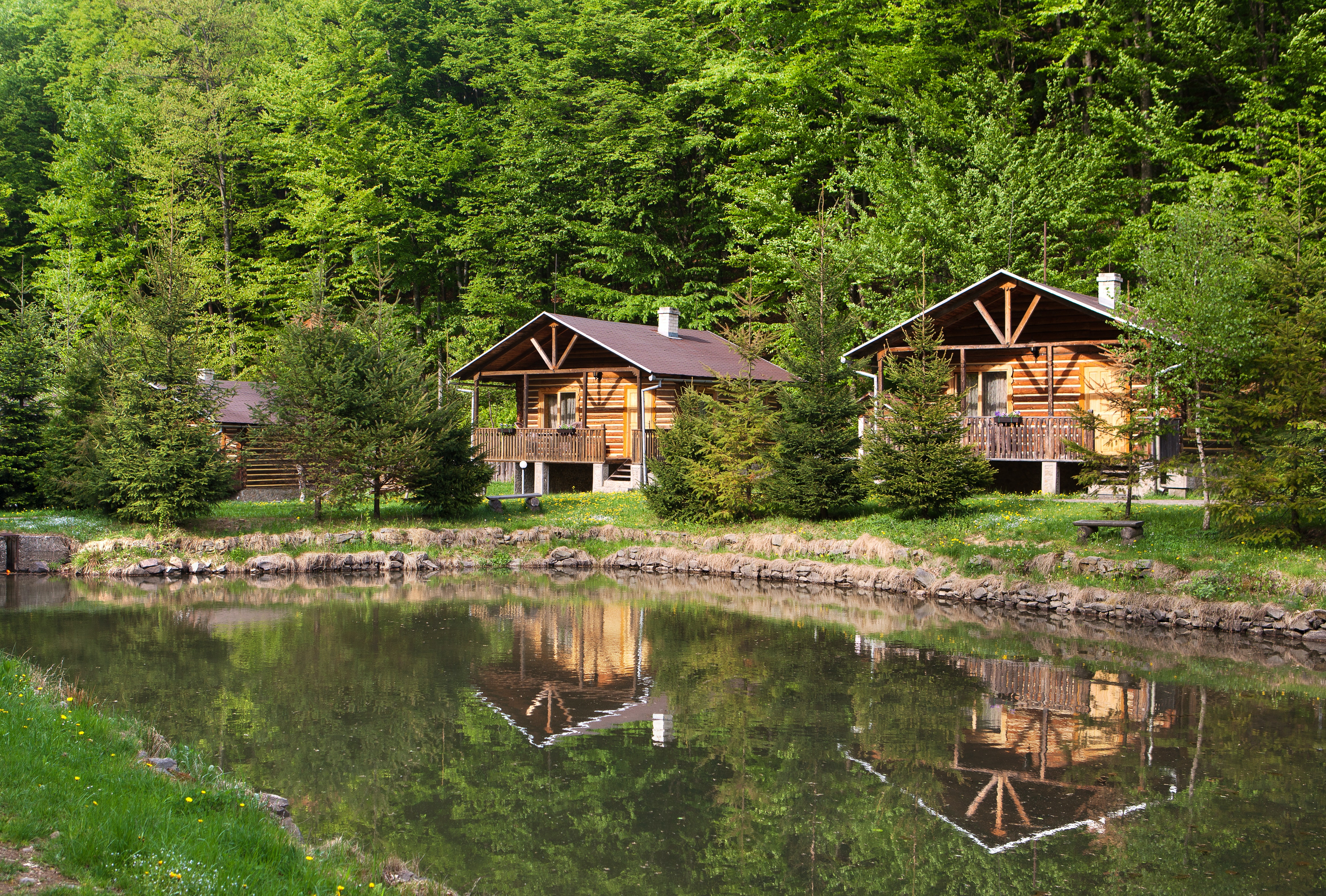 Two wooden chalets by the lake