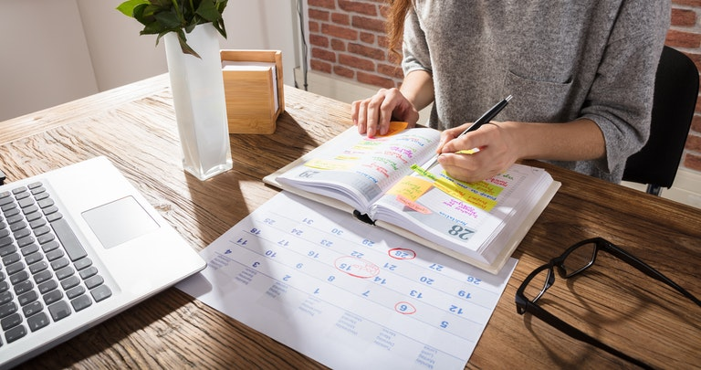 Woman marking the best time to switch energy in a diary