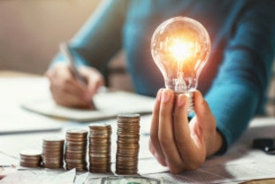 Price cap represented by money saving and a lightbulb