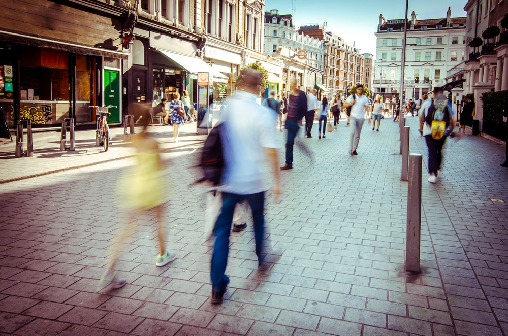 People walking down a busy high street