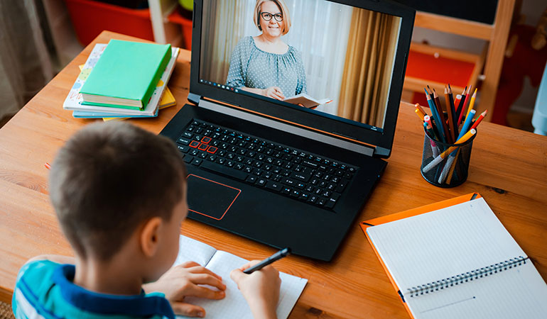child learning from home in a virtual classroom