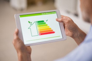 Man looking at Energy Performance Certificate on tablet