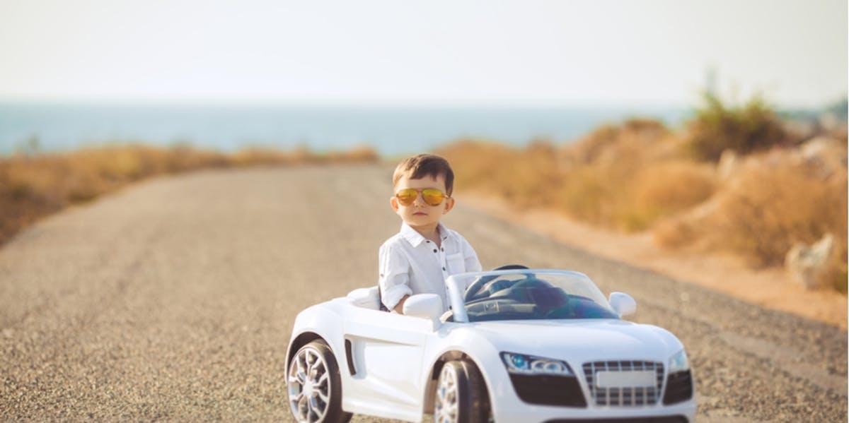 Boy in toy car