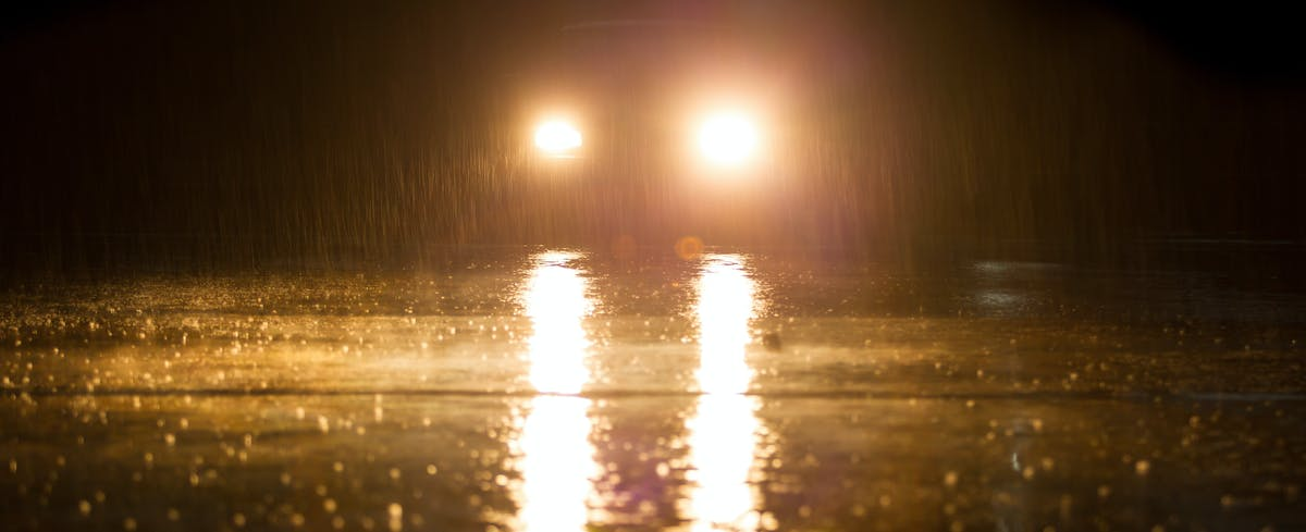 Car driving in the dark and rain