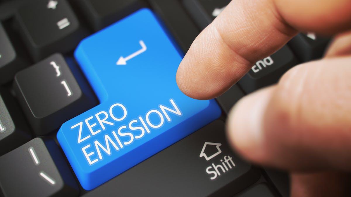 Keyboard with 'zero emission' written on the enter key in blue