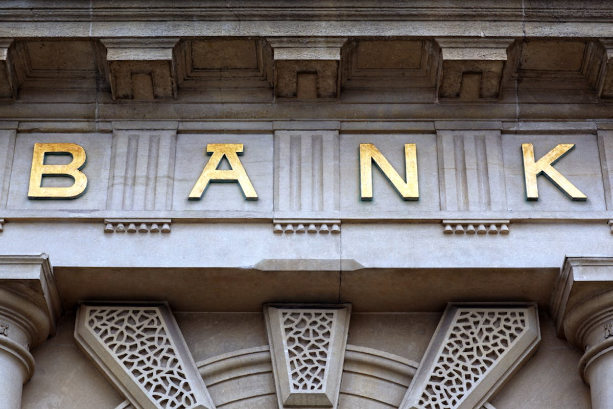 Biggest mortgage lenders in the uk. Building with 'bank' written on the facade in gold lettering