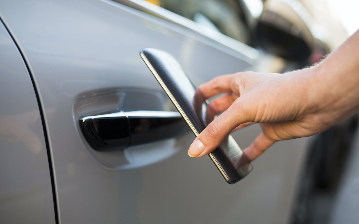 Is data security keeping up with connected cars? - opening a car door with a mobile phone