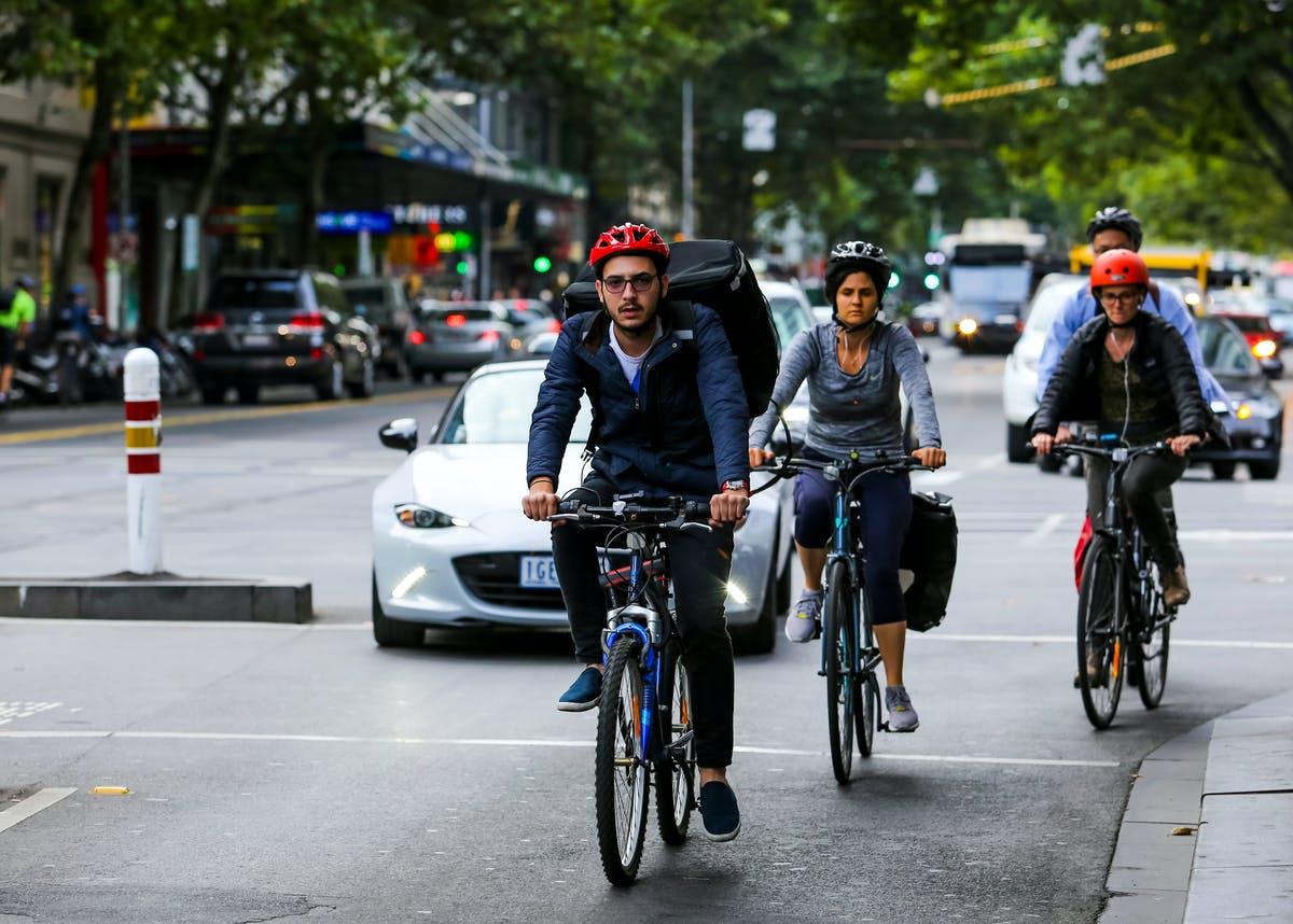 Cyclists in a group, blocking cars
