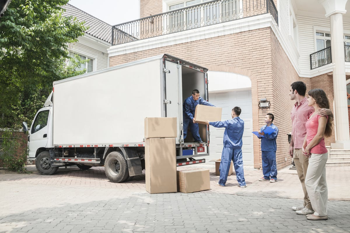 Step by step guide to buying a home - couple who are moving home watch removal team work