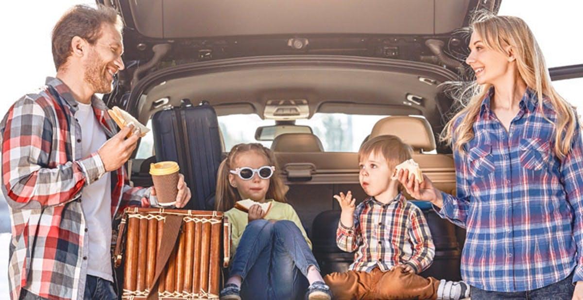 The Ultimate Road Trip Snacks - kids in boot