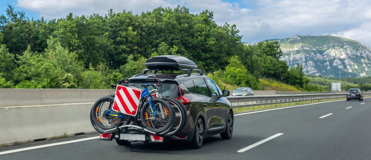Car with roof box and bike rack
