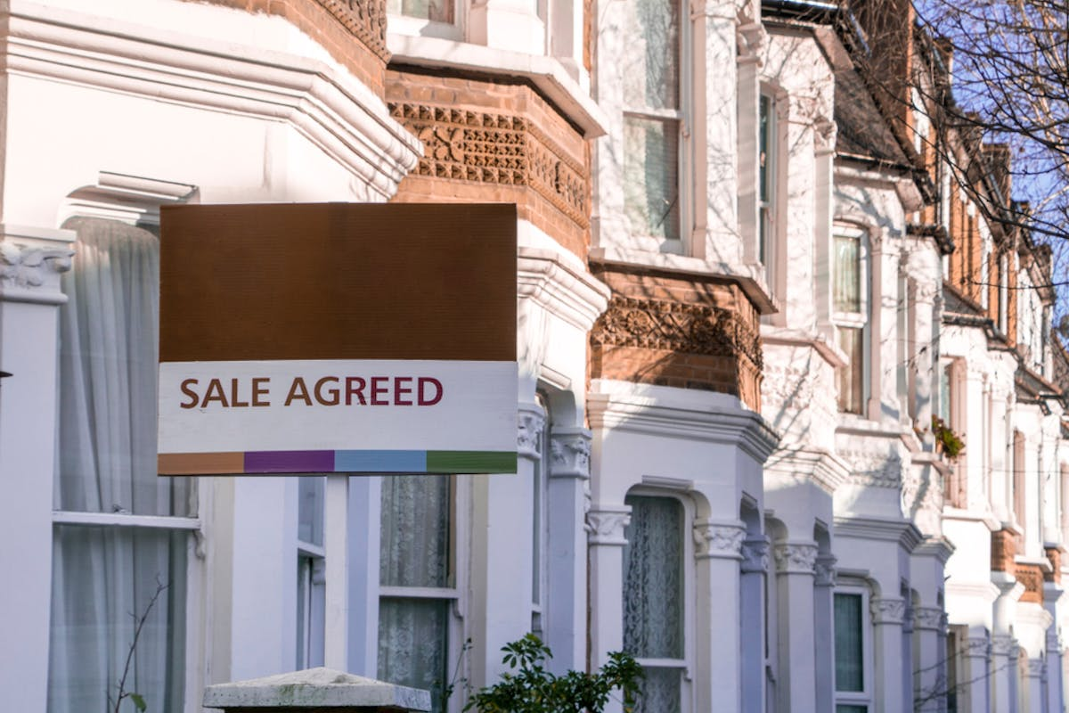 What is a first time buyer mortgage? Image of a sale agreed board outside a house.