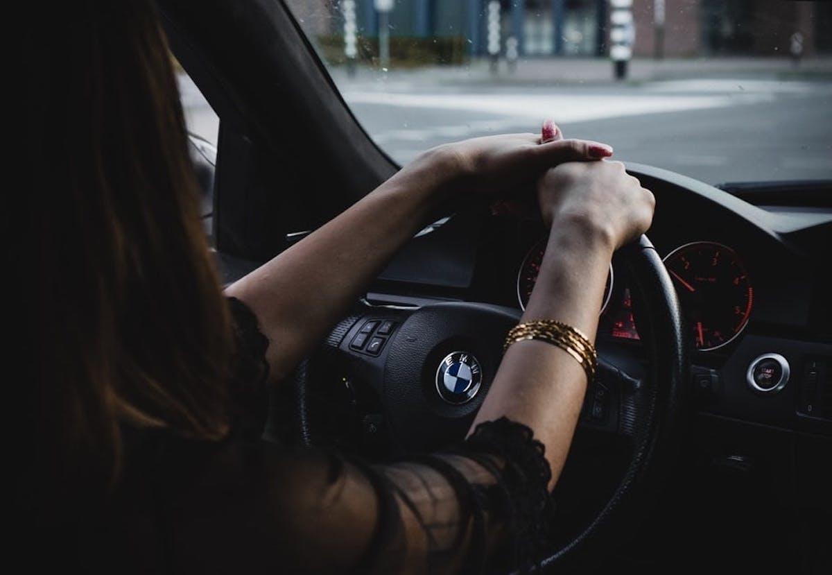 Woman driving newly insurance car.