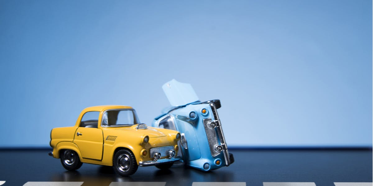 Two toy cars involved in a car accident