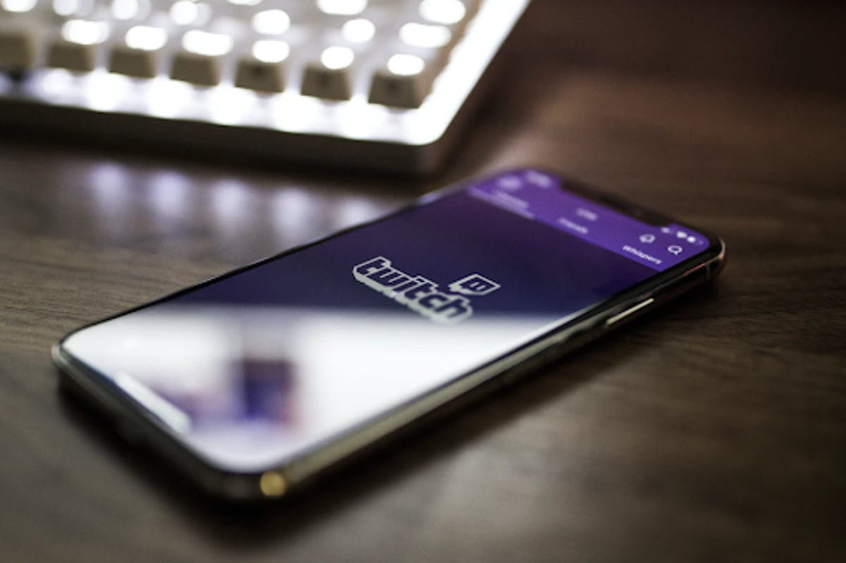 Phone with twitch logo on screen