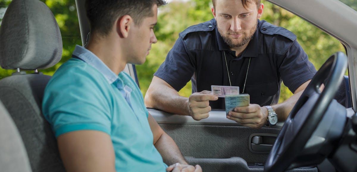 Policeman checking Drivers' ID