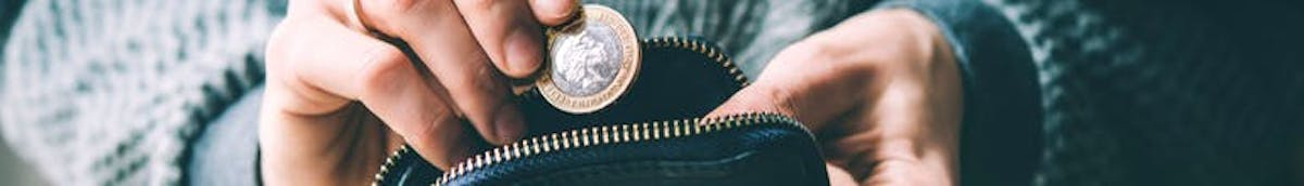 Dropping £1 coin into a purse