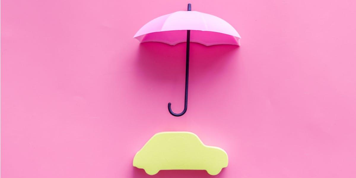 Car underneath an umbrella