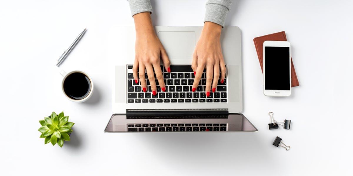 Laptop on white table