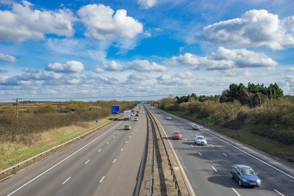 M1 motorway in UK with blue sky at sunny day