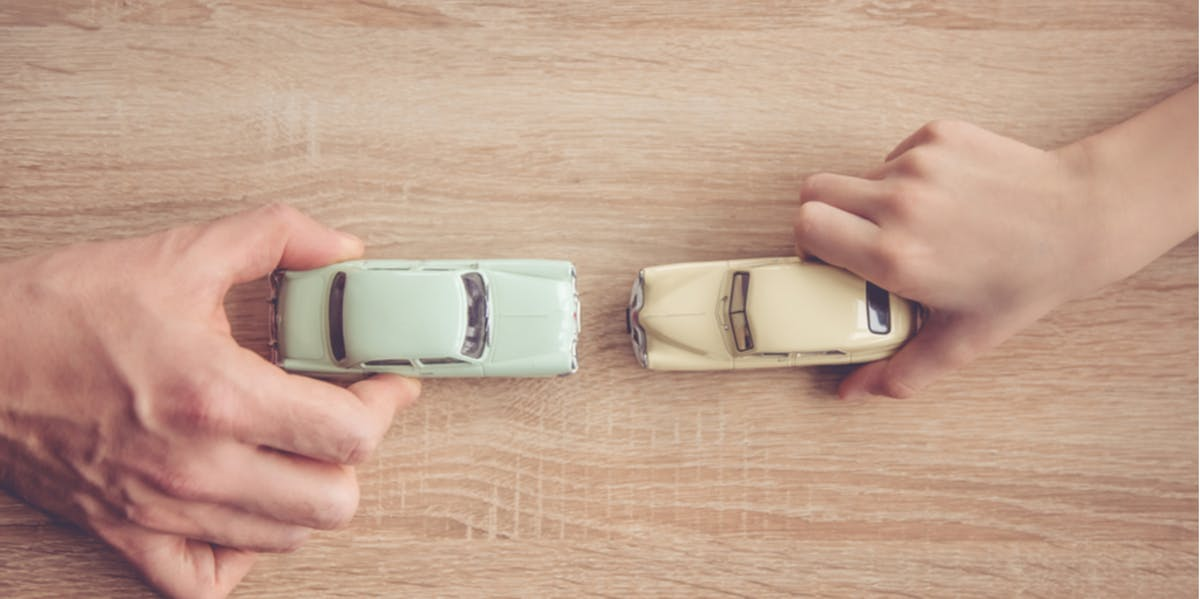 Adult and child playing with cars
