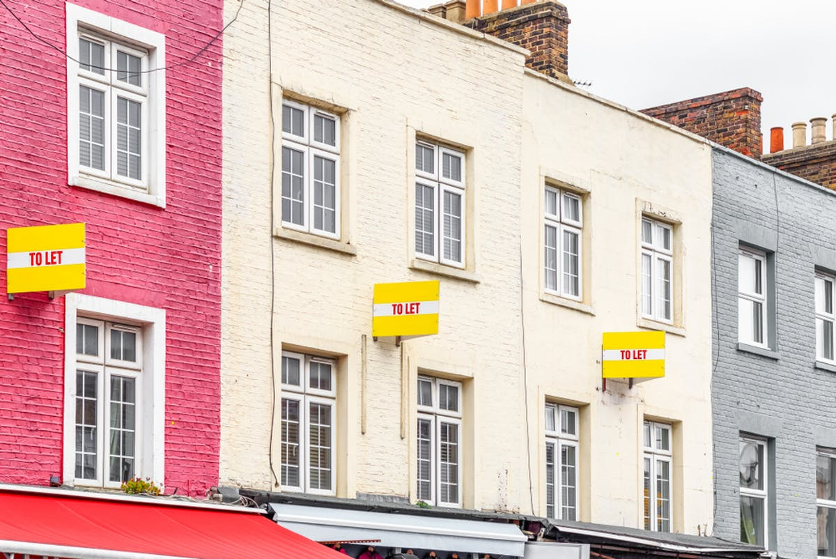 How to become a buy to let landlord. Image of colourful houses with To Let boards.