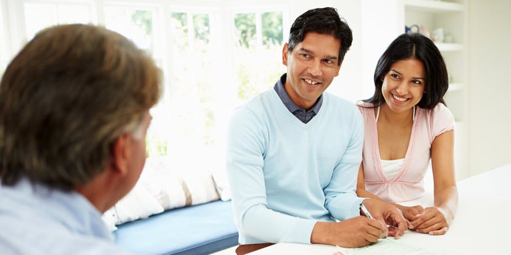 Couple discussing finances with advisor
