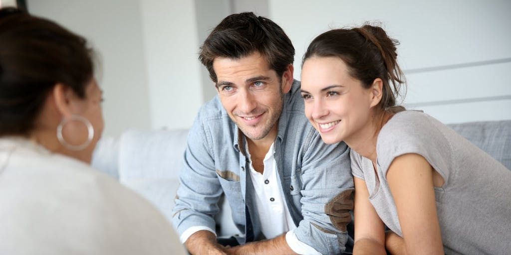 Young couple smiling meeting with adviser