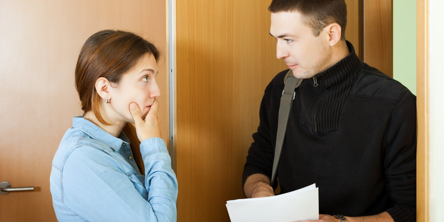 Debt collector talking to woman