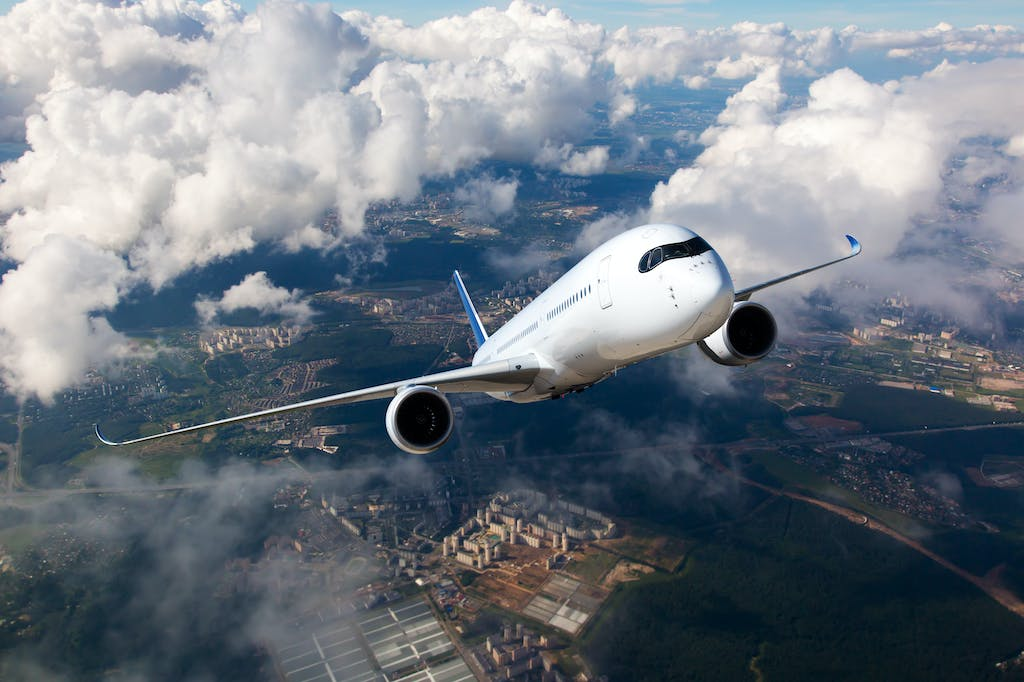 Plane contributing to carbon footprint taking off