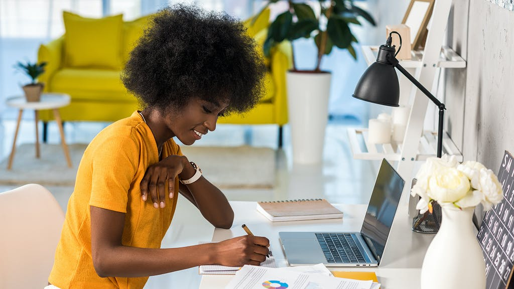 smiling female freelancer working at home