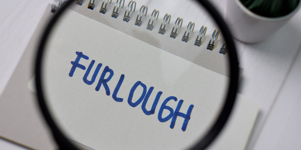 Furlough Written on paper and Magnified