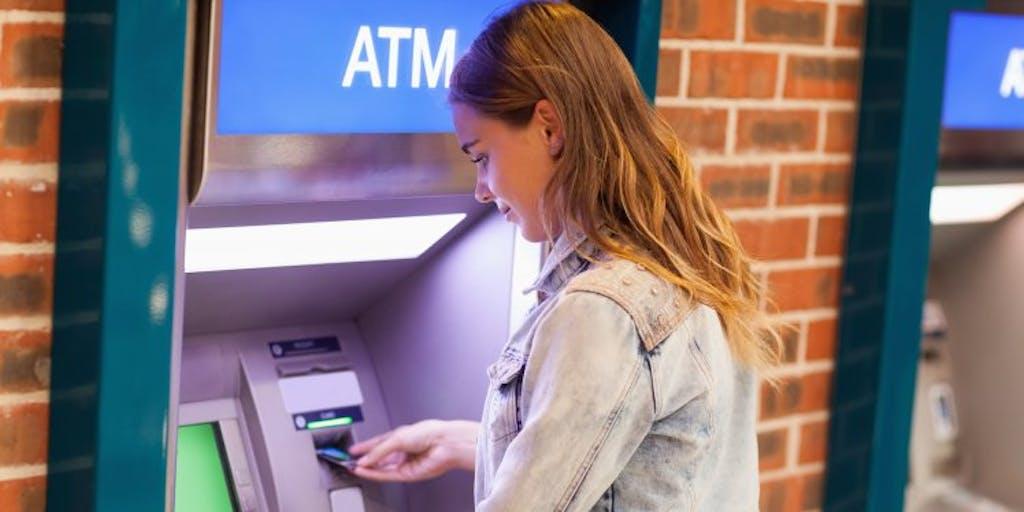 woman-using-cash-machine