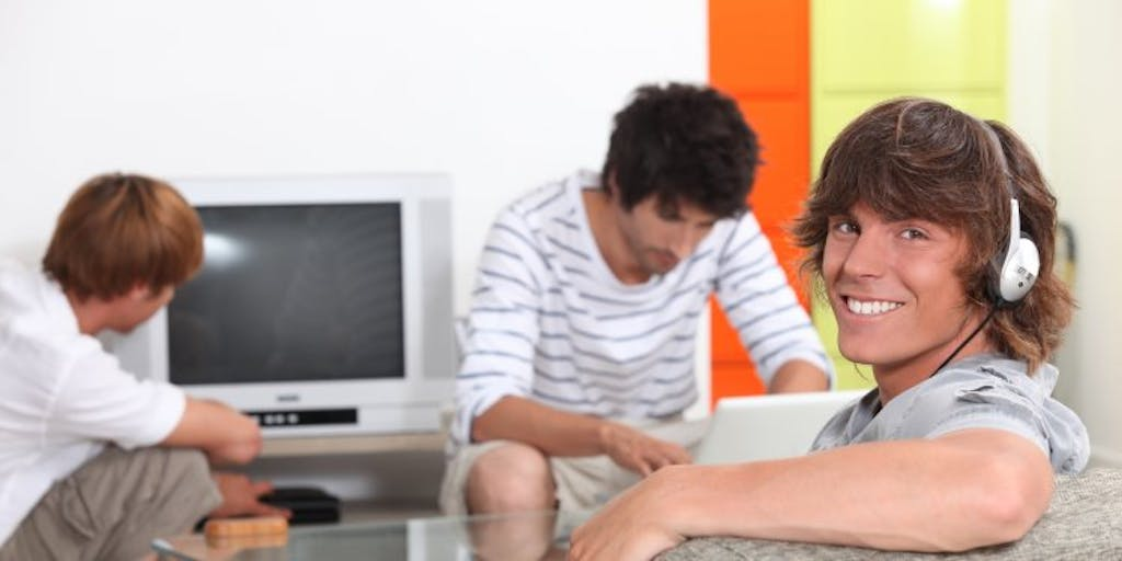 students watching tv on sofa