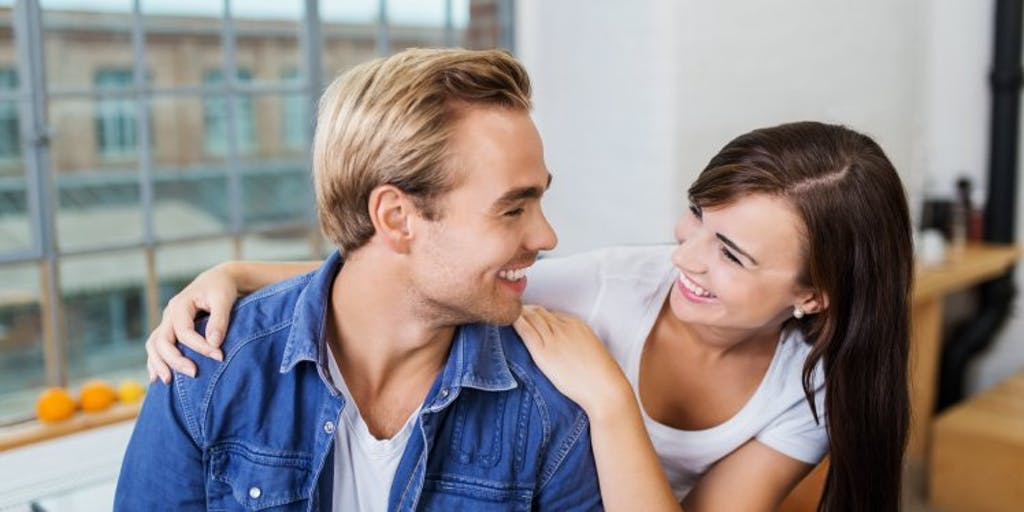 Young couple smiling at each other.
